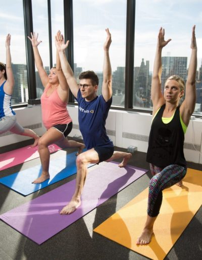 image of people doing yoga exercise