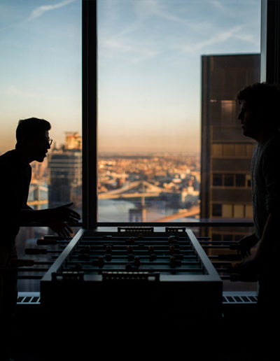 image of two people playing foosball