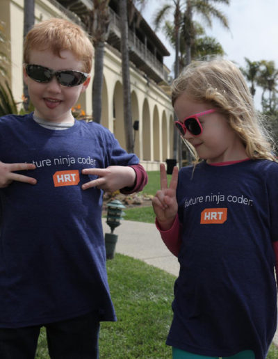 Photo of two children with HRT t shirts
