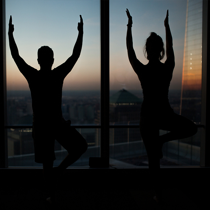 two people in yoga pose
